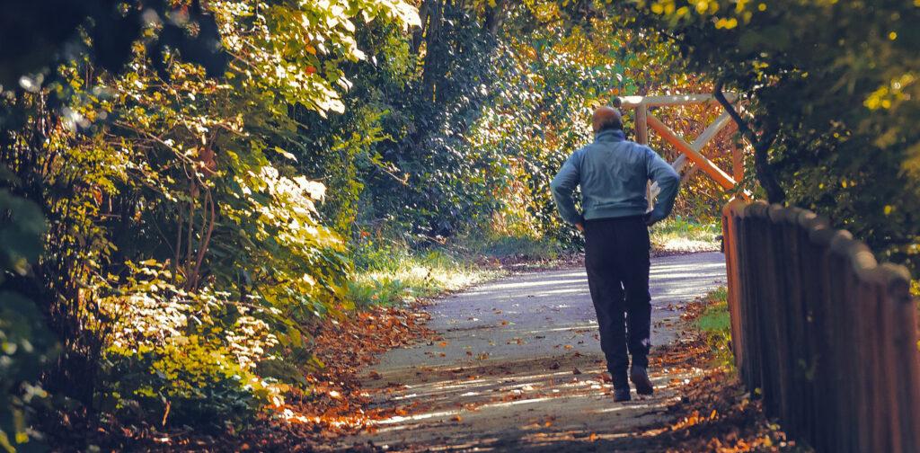 man walking in park